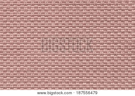 Dark pink woolen background of dense woven bagging fabric closeup. Structure of the rose cloth with natural texture. Cloth backdrop.