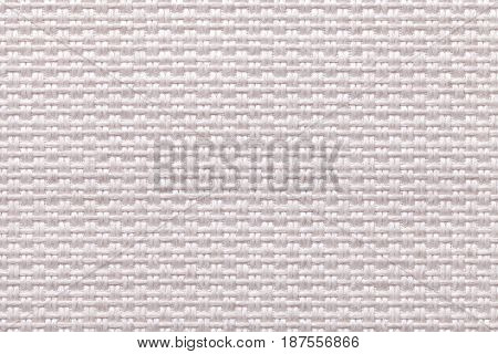 Light pearl woolen background of dense woven bagging fabric closeup. Structure of the white cloth with natural texture. Cloth backdrop.