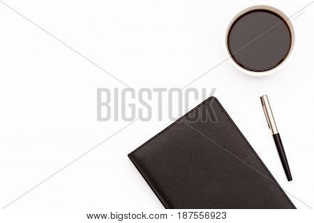 Black Diary, Pen And A Cup Of Black Coffee On A White Background. Minimal Business Concept For The W