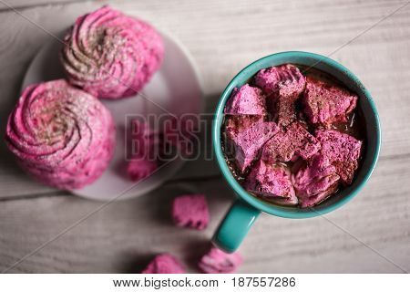 Latte With Pink Marshmallow. Winter Drink Theme. Blue Cup Of Hot Cocoa With Pink Marshmallows. Hot C