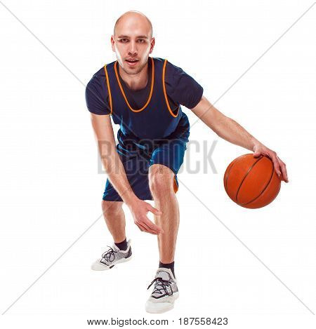 Full length portrait of a basketball player with a ball against white studio background
