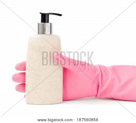 Hand in pink rubber housework glove gripping a pump bottle of cosmetic lotion isolated on white