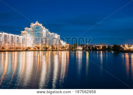 Minsk, Belarus - September 3, 2016: Residential House Near Trinity Hill Suburb, Svisloch River In District Nemiga At Summer Evening Or In  Night Lights Illumination.  View From City River's Embankment