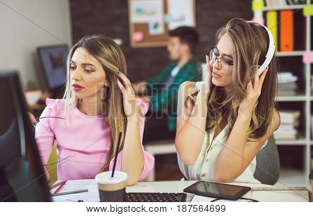 Two young woman at office working on a new creative design