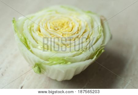 Cut Chinese Cabbage Stalk On A Wooden Table. Top View