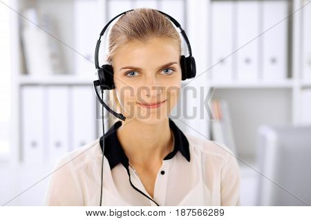 Modern business woman in headset the office.