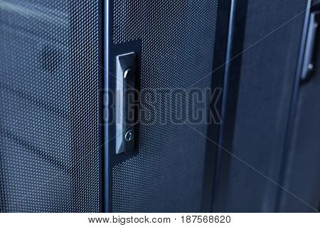 Modern lock. Close up of a locking button on the door in the server room