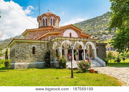 Philippi, Greece - April 30, 2016: St. Lydia, first European Christian, baptistry church, Lydia, Philippi, Greece and people near the entrance