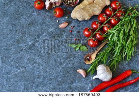 Food background with different ingredients on a marble background. Cherry tomatoes rosemary garlic pepper lime. Top view.