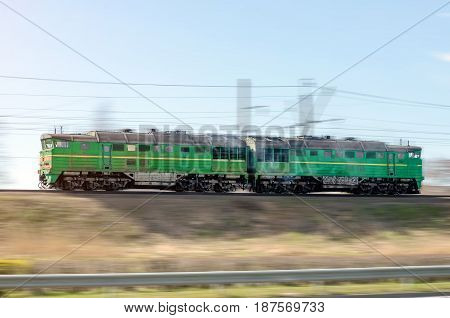 Train Double Locomotive, Green Rides At Speed By Rail.