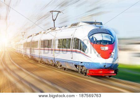 High-speed Passenger Train Rushing Through Rail In Europe.