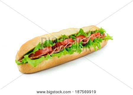 Fresh baguette sandwich with vegetables and salami isolated on white background