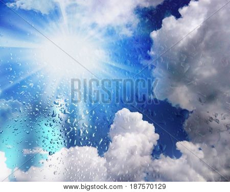 Background. Concept: The sun always shines after the rain. Rain drops on the glass and sunshine in the clouds. Sky after the storm. Day. Summer. Spring. Beauty of nature.