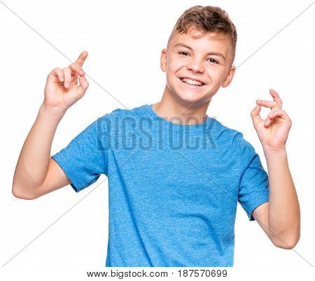 Half-length emotional portrait of caucasian teen boy wearing blue t-shirt. Smiling teenager looking at camera. Handsome happy child, isolated on white background.