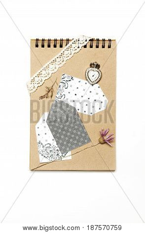 Label stickers on craft paper notebook and pressed flowers