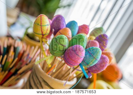 Close up of a Colorful Easter Glittery Plastic Eggs with blurred background