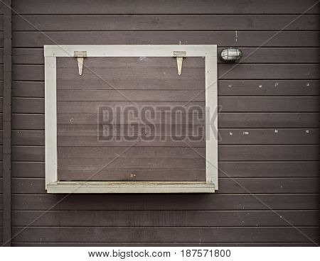 White window frame on the grunge wooden plank wall