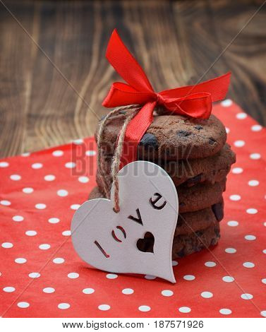 Homemade chocolate cookies in a festive package with a heart. Concept / Love / Care / Attention / Christmas / Holidays / Cute gift.