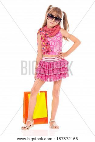 Beautiful little girl with shopping bags, isolated on white background