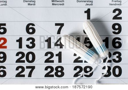 Woman hygiene protection , calendar close up.menstruation with cotton swabs used.