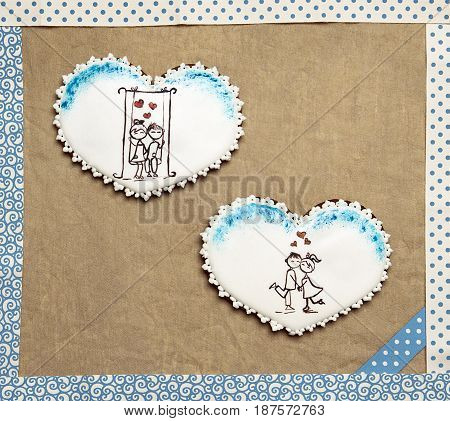 Gingerbread hearts in a frame. Craft paper background. St. Valentine gift