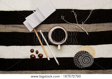 Geometry composition with coffee on a lined material