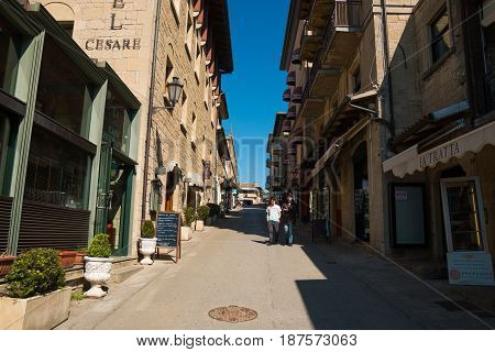 SAN MARINO, ITALY - 10.04.2017: Old little streets of San-Marino with tourists Europe
