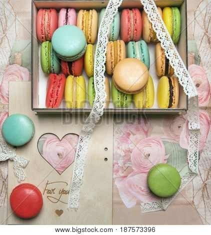 Macaroons in the box on vintage background