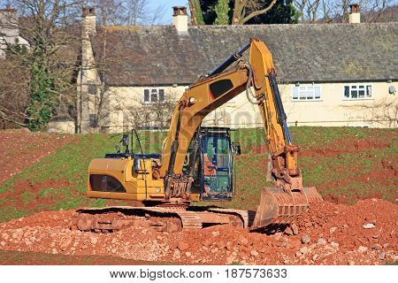 Digger working on a road construction site