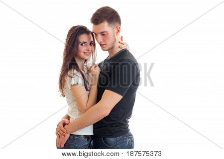 beautiful romantic couple stand together and hug isolated on white background