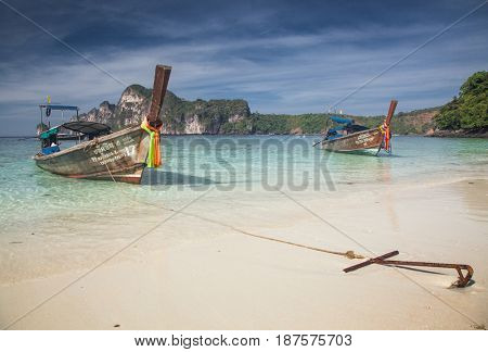 KO PHI PHI, THAILAND, February 1, 2014: Tropical beach with traditional long tail boats on the beach of Ko Phi Phi, Andaman Sea, famous tourist destination in Thailand
