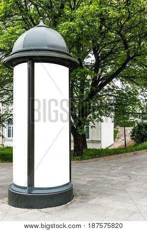 Mock up. Retro style street advertising column stand on sidewalk