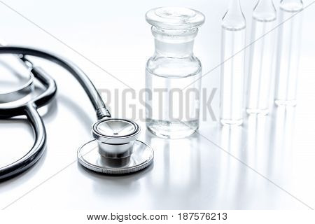 medicine set with stethoscope and vials on doctor's office workplace background
