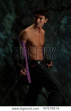 The hot vampire is taking off his shirt.