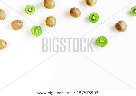 exotic fruit mockup with sliced fresh kiwi on white table background top view