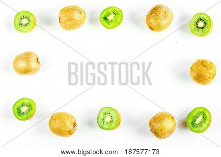 exotic fruit frame with sliced fresh kiwi on white table background top view mockup