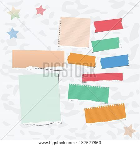 Ripped colorful note, notebook, copybook paper strips stuck on gray background