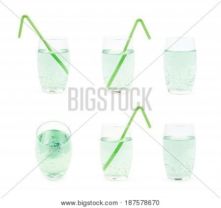 Tall glass filled with the carbonated green lemonade water and served with a drinking straw, composition isolated over the white background, set of six different foreshortenings