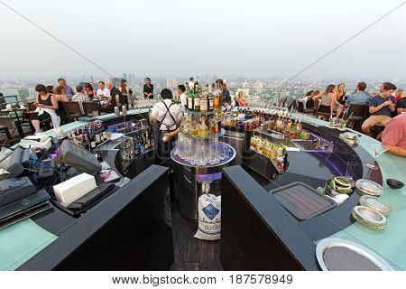 BANGKOK, THAILAND - FEBRUARY 10, 2017 : People drinking and enjoying the sunset at the Octave rooftop bar of the Marriott tower hotel in the Thong Lor district, Bangkok, Thailand