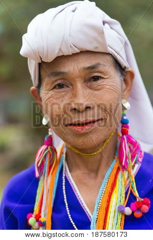 MAE KLANG LUANG, THAILAND - FEBRUARY 18, 2017 : Portrait of a Karen tribe woman wearing traditional clothes in the Mae Klang Luang village near Chiang Mai, Thailand