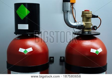 Ready for usage. Professional modern fire extinguisher being ready to be used in case of fire emergency
