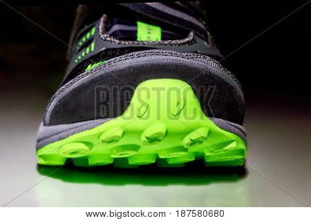 the image sneakers on a dark background front view