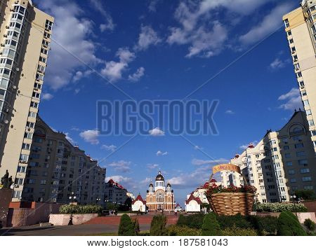 KIEV - UKRAINE - MAY 2017: Panorama of Obolon district in Kiev.The Orthodox church stands in the courtyard against the beautiful cloudy sky. Along the sides of the high-rise church