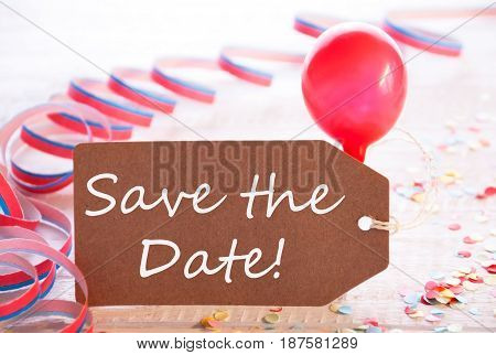 One Label With English Text Save The Date. Party Decoration Like Streamer, Confetti And Balloon. Wooden Background With Vintage, Retro Or Rustic Syle