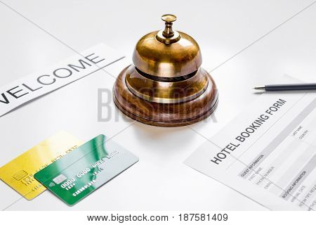 room reservation form on hotel reception desk background