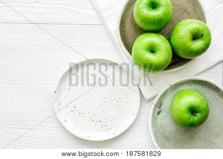 green apples for healthy fruit dessert on white table background top view