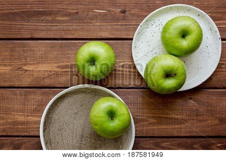 ripe green apples on wooden table background top view