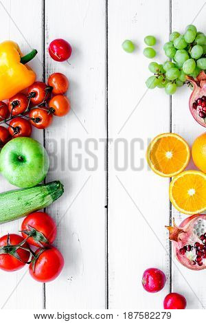summer food with fresh fruits and vegetables on white background top view space for text