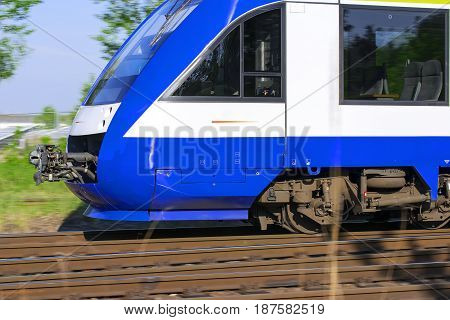 Beautiful express train, races by rail summer morning