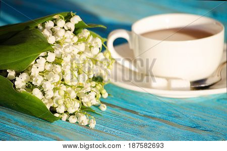 Hot Tea In A White Cup With A Bouquet Of Flowers